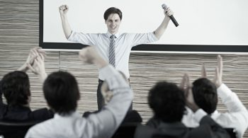 Happy businessman finishing his presentation with success